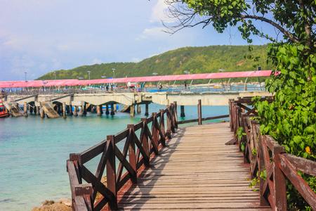 wooden bridge around the coast of island