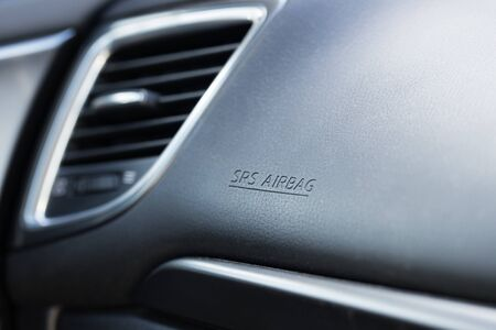 shallow depth of field of a car dashboard with focus on the word air in SRS airbag