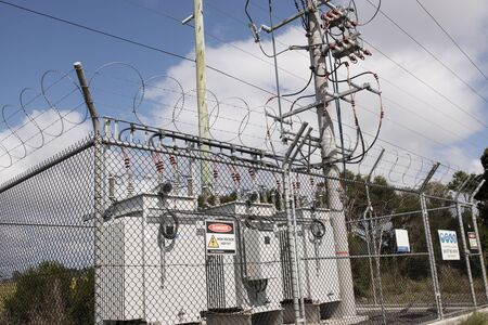 High voltage electicity substation surounded by fence