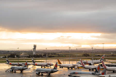 Melbourne Tullamarine airport with Virgin, Jetstar and Tiger aeroplanes grounded on the tarmac during the Corona COVID-10 pandemic, the air traffic control tower is in the back ground