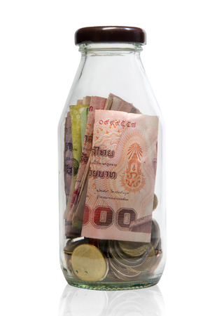 baht: saving thailand  coins and bill  in close bottle white background Stock Photo