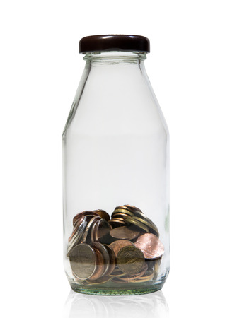baht: saving thailand  coins  in close bottle white background