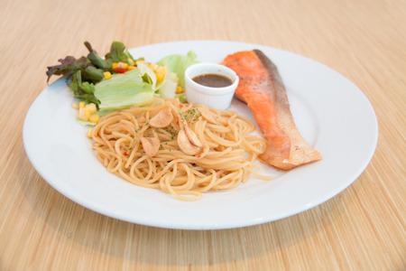 Pasta with salmon on wood  photo