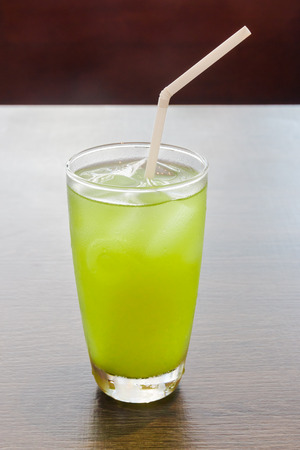 ice green tea with straw  on a wood table photo