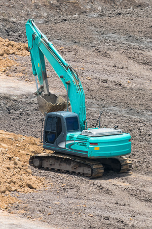 tracked: A large trackhoe or tracked excavator moving rock