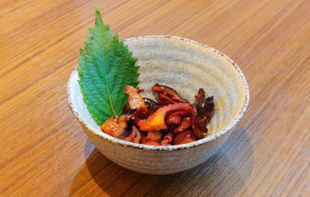 seasoned: Seasoned Baby Octopus   dish on wood table close up