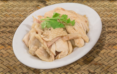 Steam chicken for eat with rice on weave bamboo