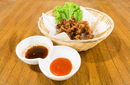 tendons: deep fried pork tendons with delicious taste on white background