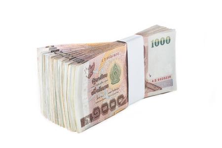 of siam: Thai baht banknotes on white background Stock Photo