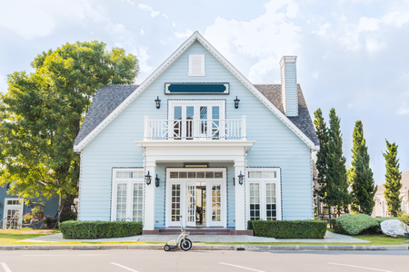 single dwellings: blue house with beautiful landscaping Home exterior Stock Photo
