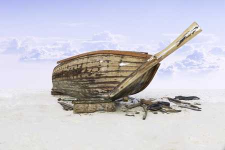 assemble: assemble  fishing boat on sand with blue sky Stock Photo