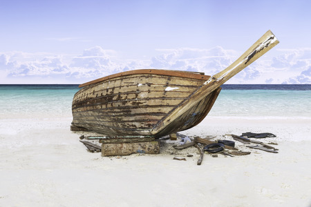 assemble: assemble fishing boat on sand with blue sky and sea