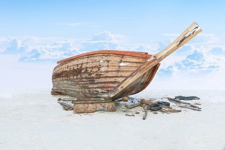 assemble: assemble fishing boat on sand with sky Stock Photo