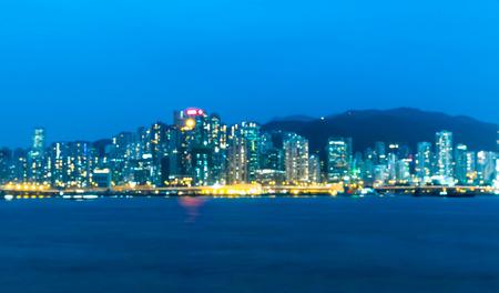 Cityscape floue bokeh lumière vue de fond pendant le crépuscule à Hong kong Banque d'images - 65458701