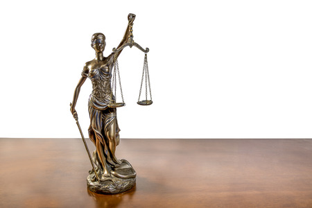 Lady Justice on wooden table