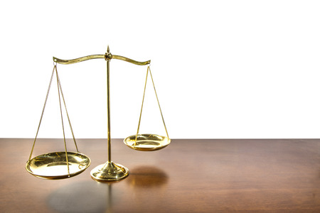 Balance of Justice on wooden table Stock Photo