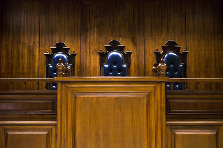 proceedings: Empty bench with judge chairs in courtroom Stock Photo