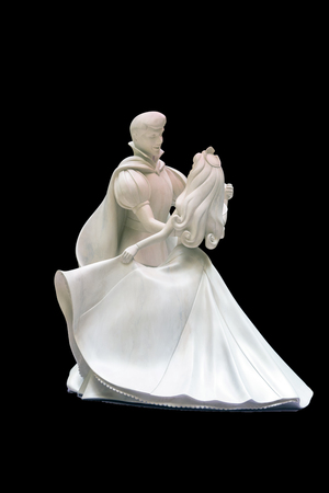 companionship: Romantic scene of a fabulous prince and princess dancing figure isolated on black background