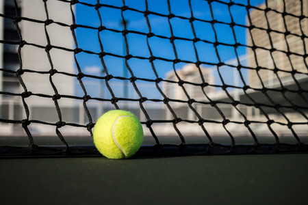 Tennis ball on tennis court Stock Photo