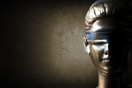Face of Lady Justice in dark brown background Stockfoto