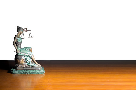 Lady justice or Themis on wooden table isolated on white background