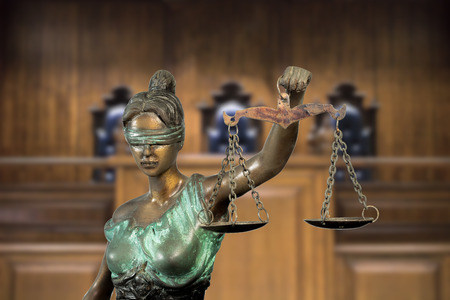 Lady justice or Themis on bench background