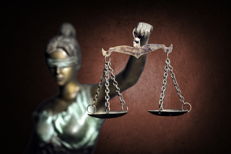 Lady Justice on ruddy background Stockfoto