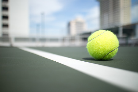 Tennis ball on green tennis hard court Stock Photo
