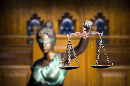 Lady justice or Themis isolated on bench background