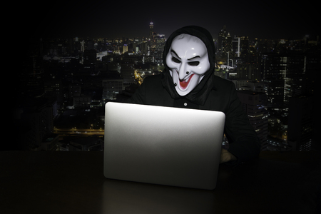 spy ware: Computer hacker stealing data from laptop (Concept for network security) Stock Photo