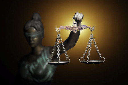 Lady Justice on emerald background Stock Photo
