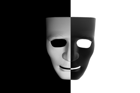 Black and white mask (half-half) on contrast background