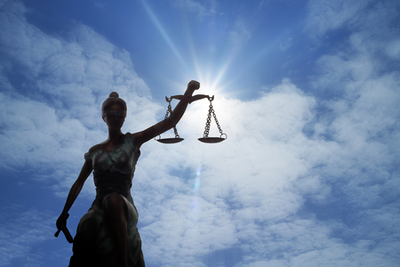 Silhouette of Lady of Justice and light of God Standard-Bild