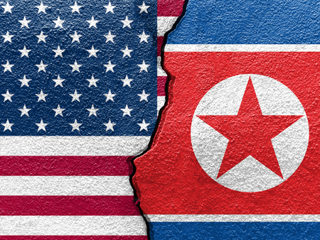 Flag of U.S.A and that of North Korea on cracked wall (Concept of international conflict)