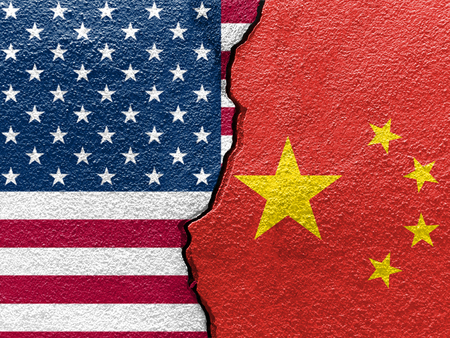 U.S.A. and Chinas flags on cracked wall (Concept of international conflict) Imagens