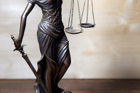 Scale of justice held by Lady Justice Editorial