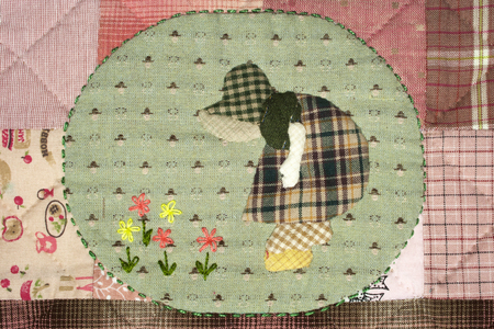 Quilt : Girl and flower Stock Photo