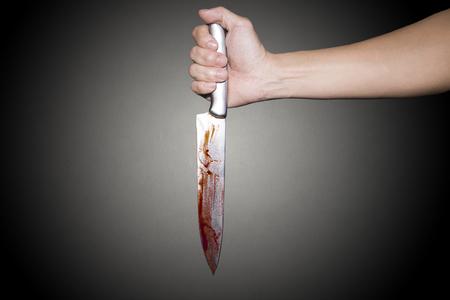 Knife with blood dripping Фото со стока