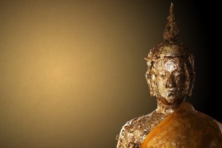 Buddha Statue on golden background with clipping path Stock Photo