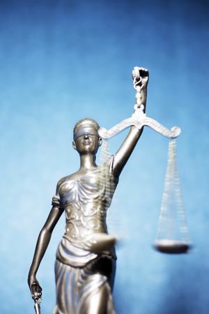 Lady Justice or Themis on blue background