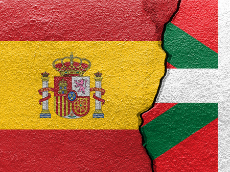 Basque and Spain flags on cracked concrete (Independence concept)
