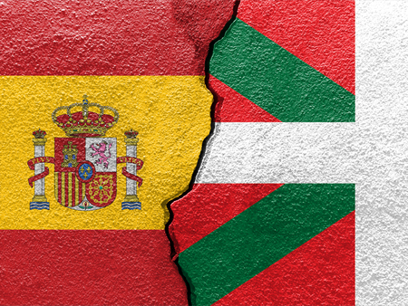 basque and spain flags on cracked concrete independence concept