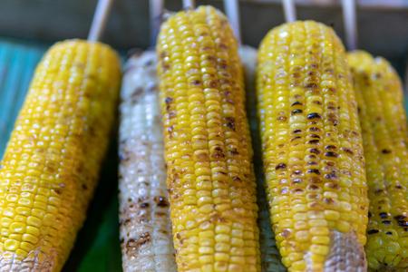 Grilled corns on banana leaf Stock Photo