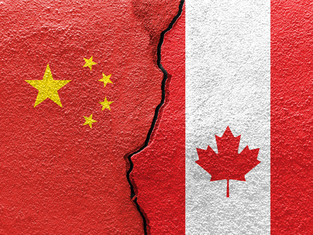 China and Canada flags on cracked concrete (International conflict concept)