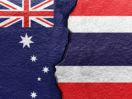 Thailand and Australia flags on cracked concrete (International conflict concept)