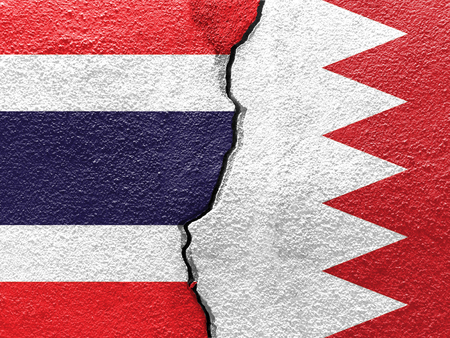 Thailand and Bahrain flags on cracked concrete (International conflict concept)