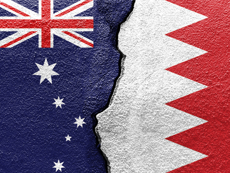 Australia and Bahrain flags on cracked concrete (International conflict concept) Stockfoto