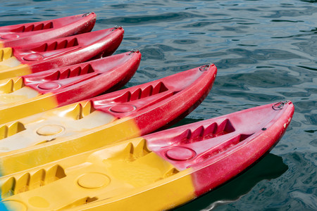 Colorful kayak boats in a row