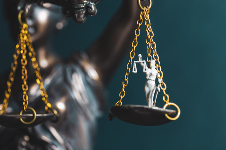 Lady Justice on another scale of Justice