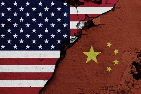 U.S.A. and China's flags on cracked wall